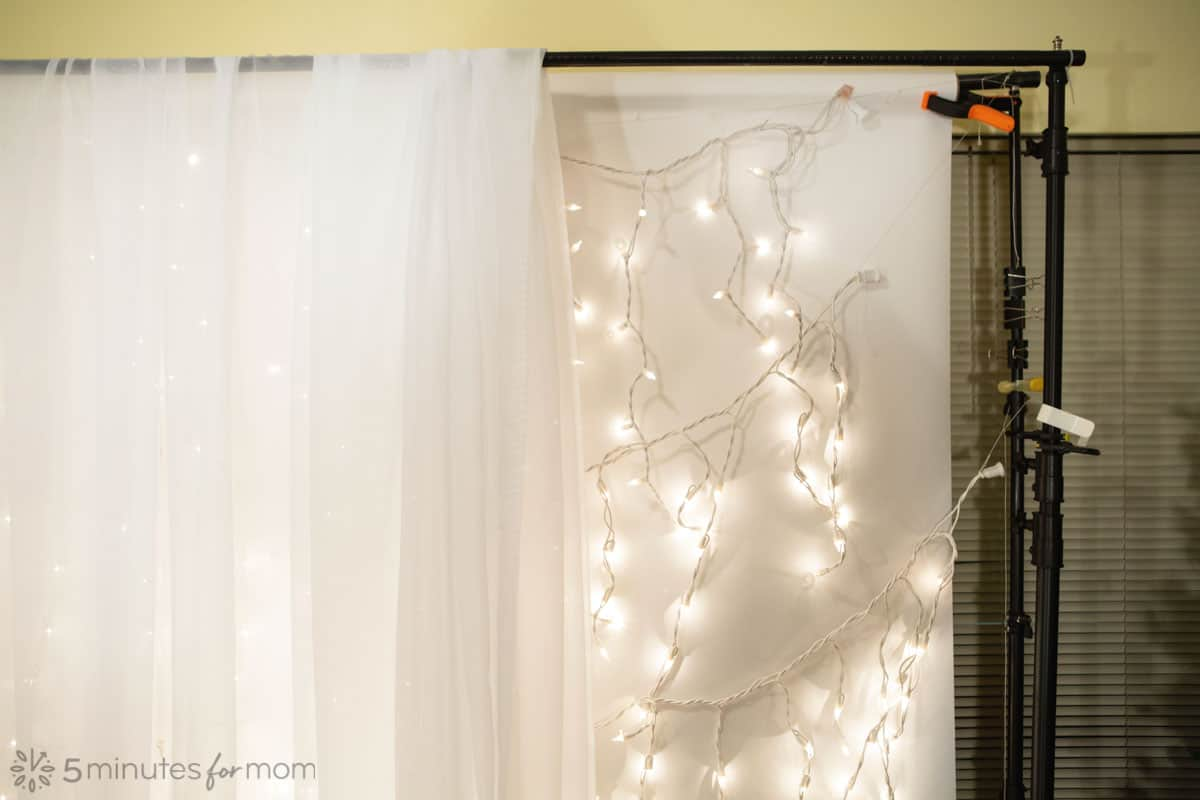 how to set up a sheer fabric backdrop with mini lights