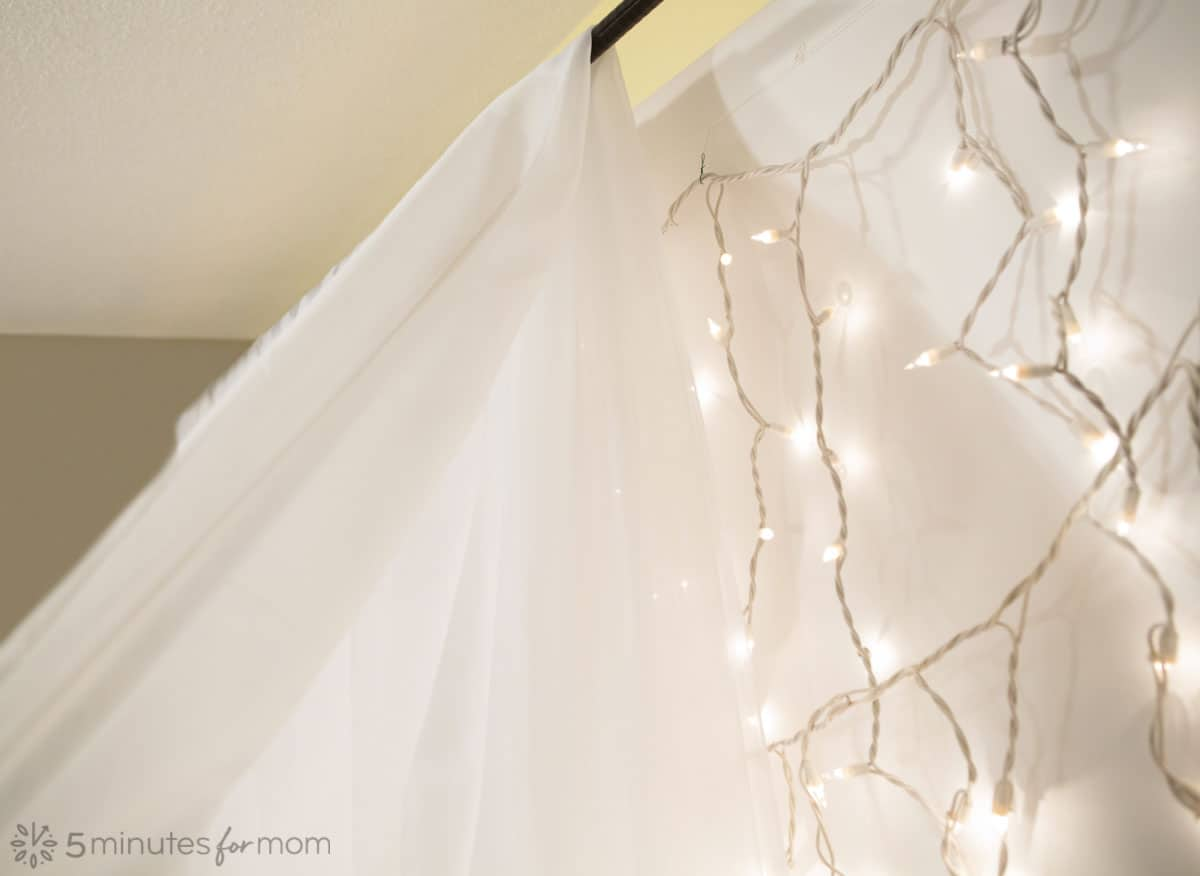 easy sheer fabric photo backdrop with mini lights