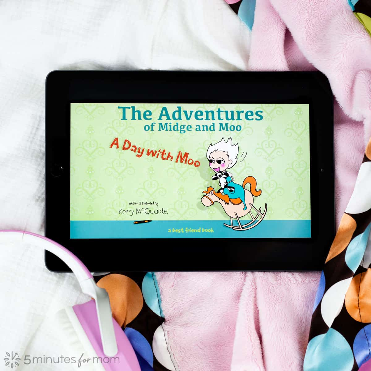 iPad with picture book for young kids