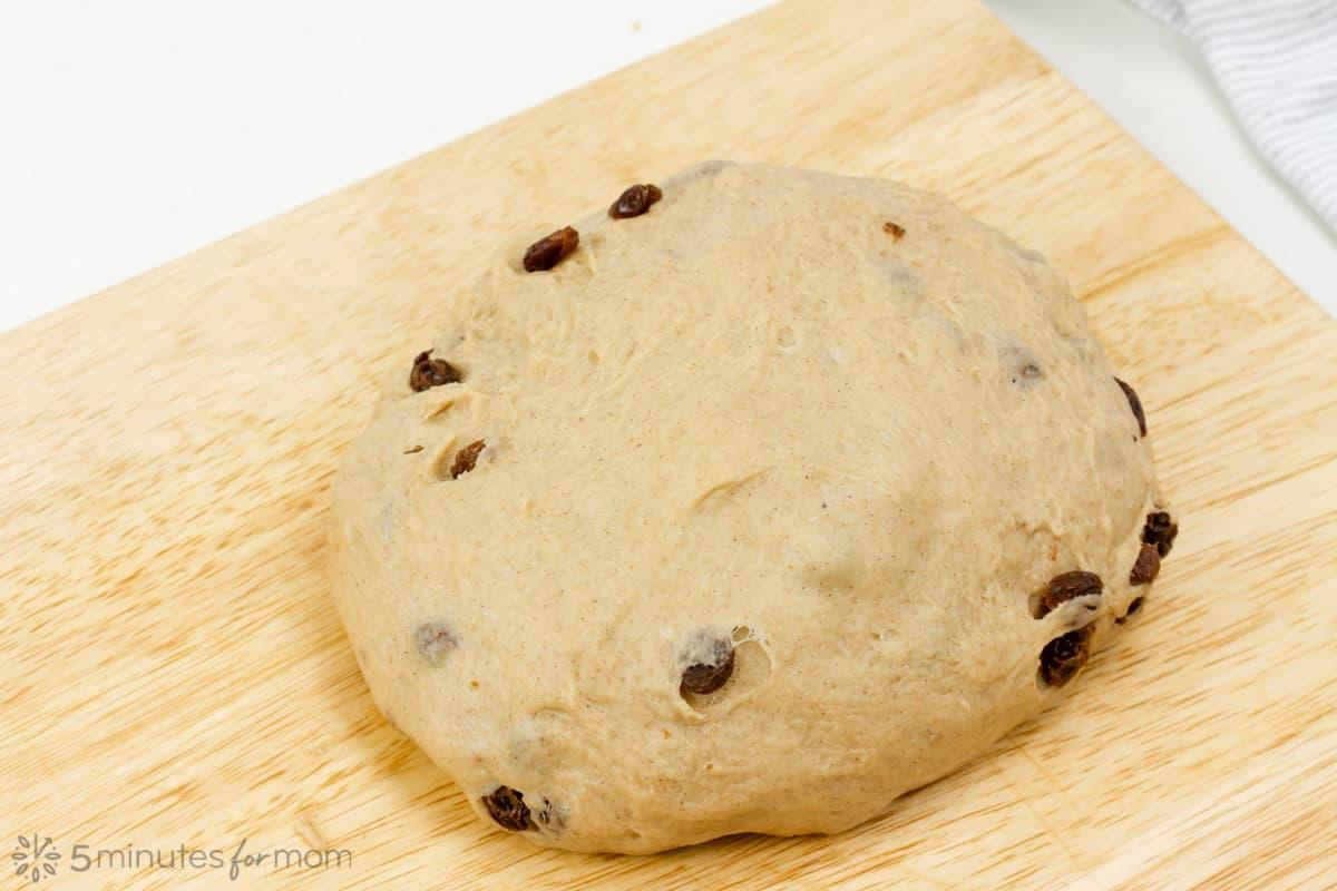 a kneaded ball of spiced dough with raisins