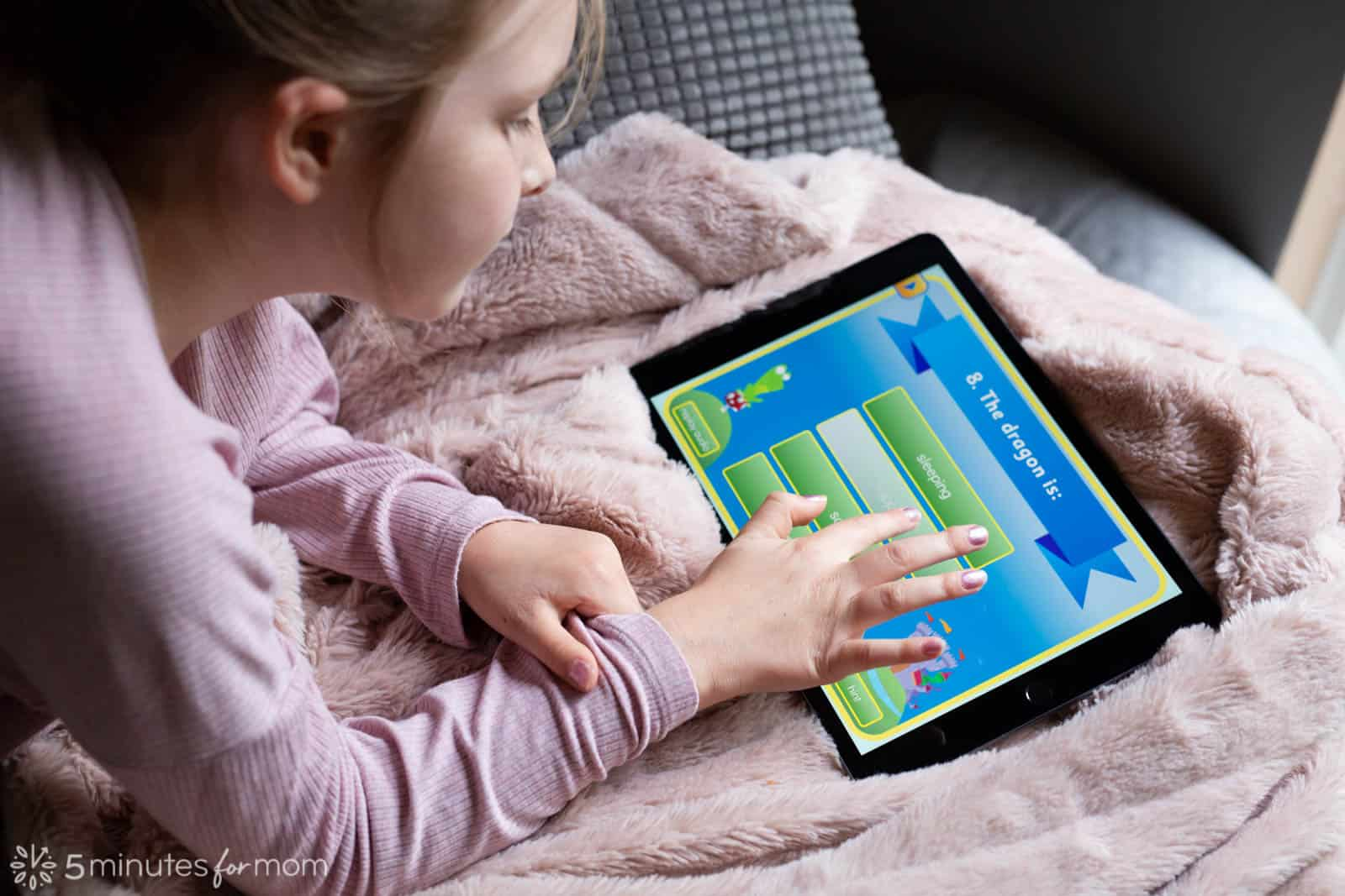 7 year old girl using to read on an iPad