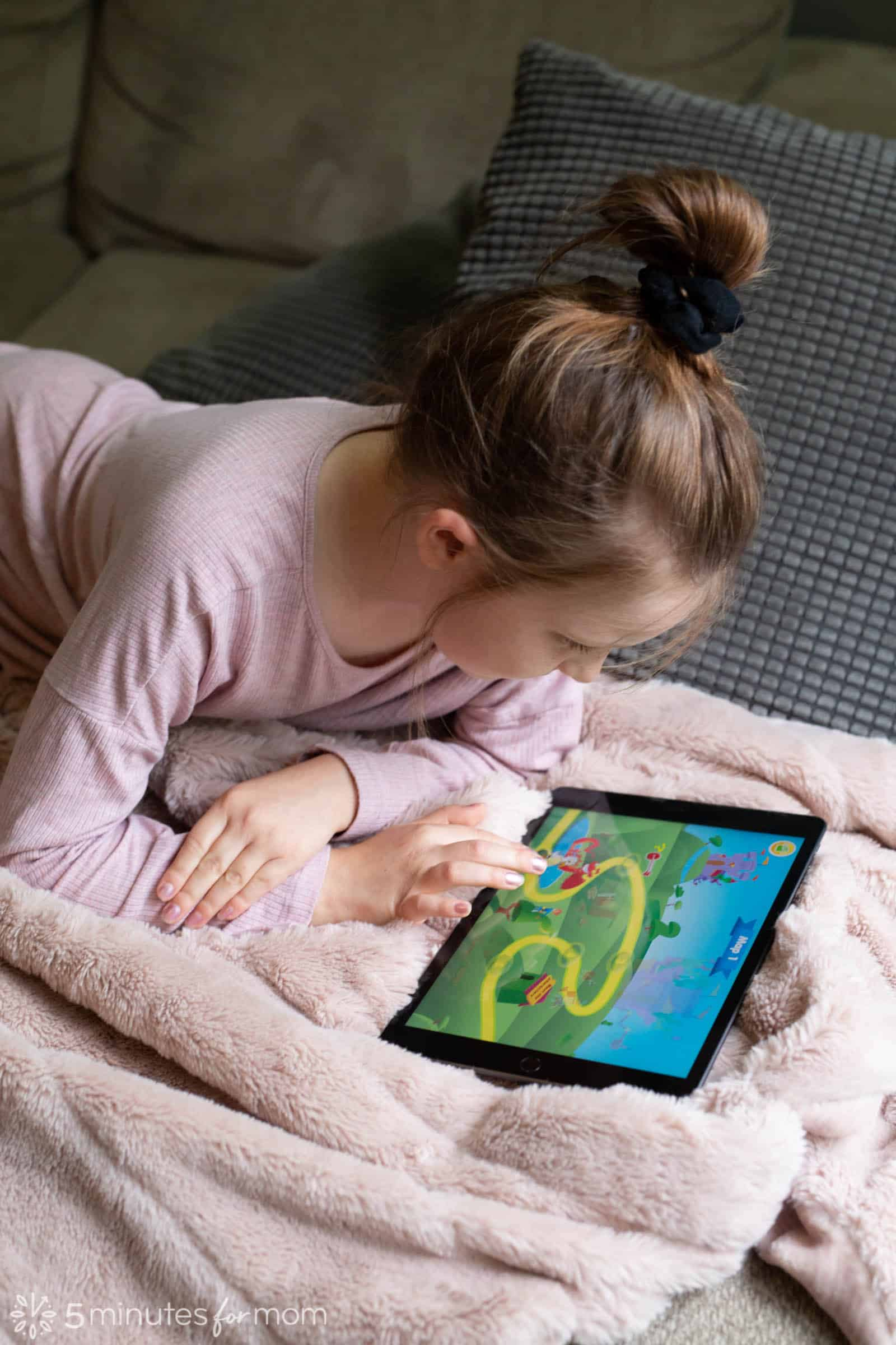 Young girl using an educational app