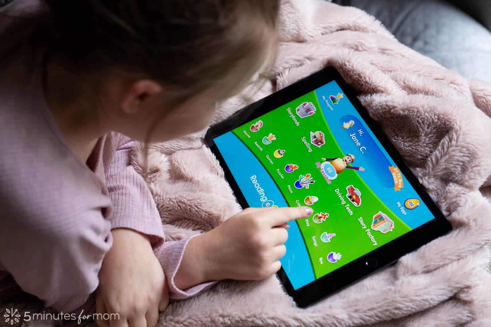 Child using Reading Eggs looking at the home screen on an Ipad